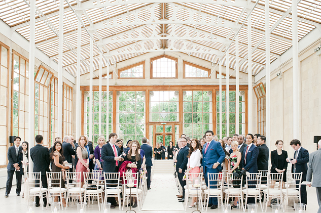 The wedding guests await in the Nash Conservatory, Kew Gardens