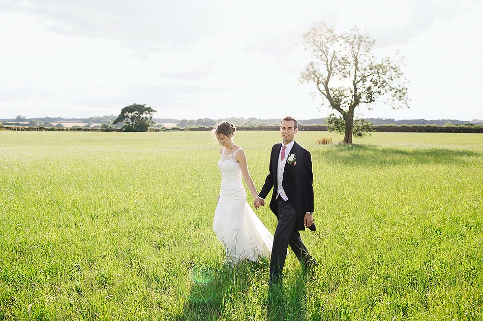 brisbane wedding photographer creative wedding photographer rustic outdoor wedding in a field wedding portraits of bride and groom sunshine coast