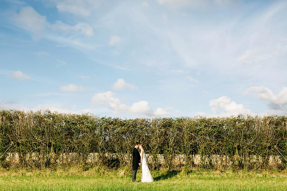 outdoor wedding photographer soft light portraits in a field