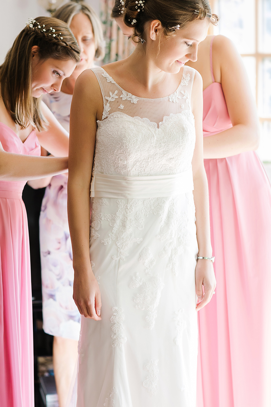 pastel pink and soft pink or peach bridesmaids dresses for wedding day