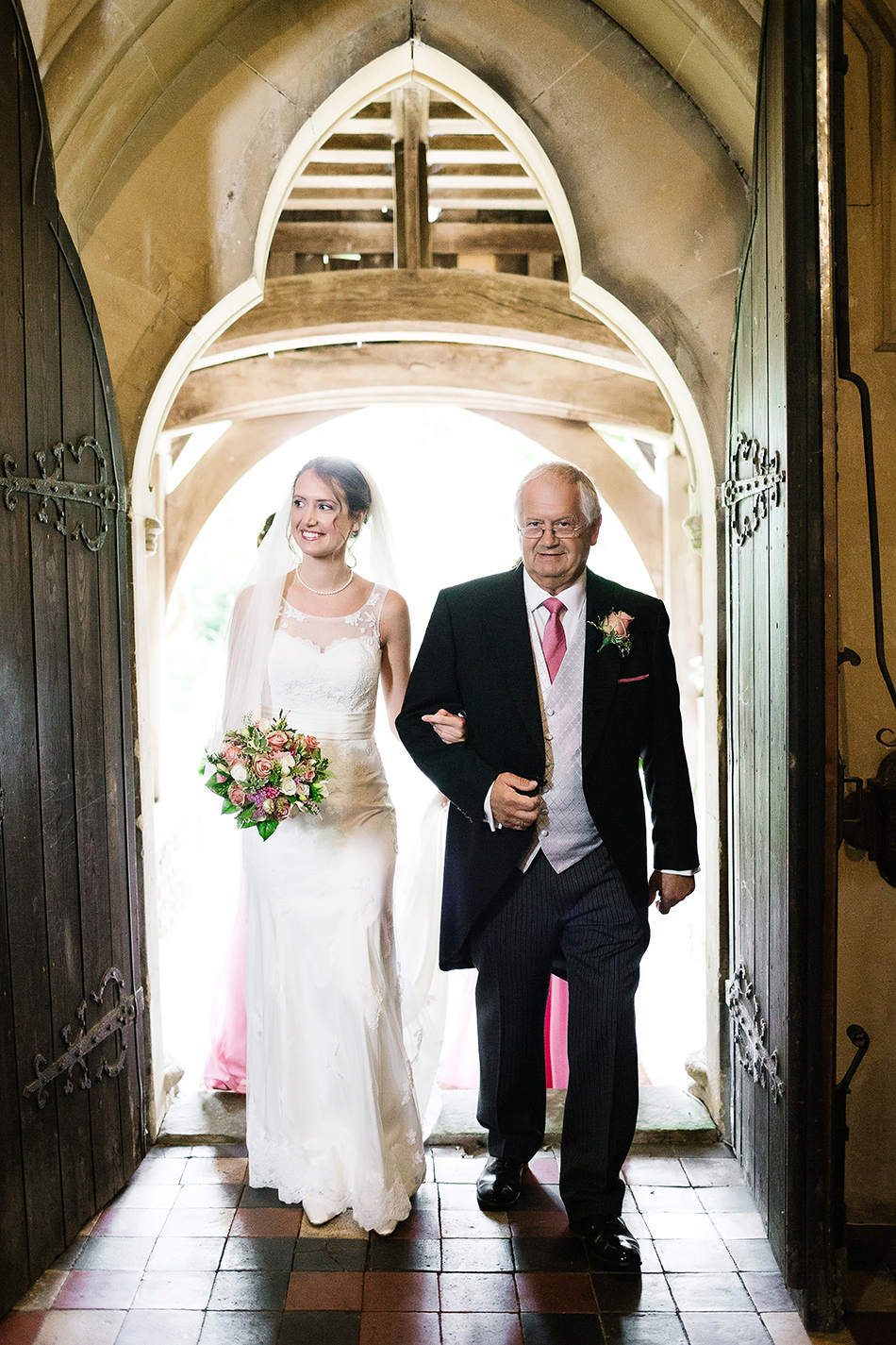 father of the bride and bride entering church on wedding day st marys