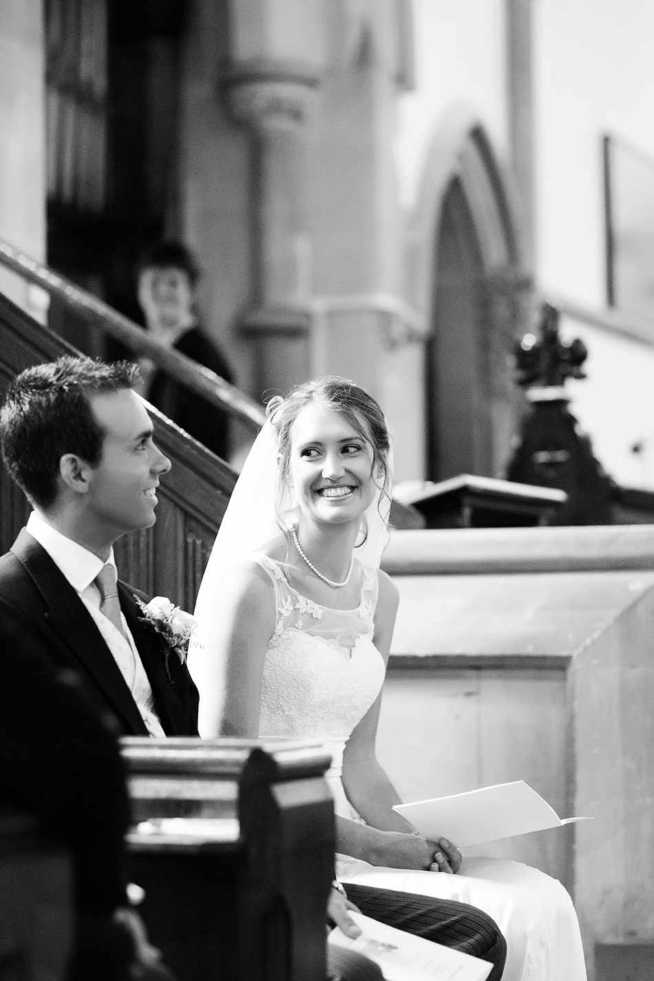 black and white wedding photography inside church of bride and groom