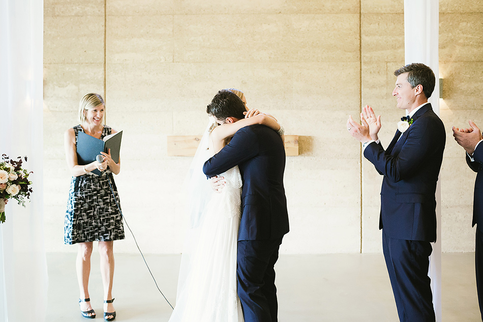 earth house wedding photographer byron bay bangalow bride and groom hugs photo