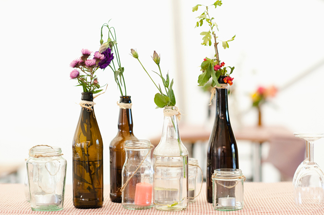 diy table decorations for a wedding including bottles and flowers