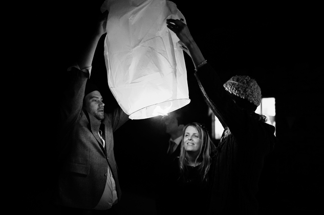 letting go of chinese lanterns at west sussex wedding