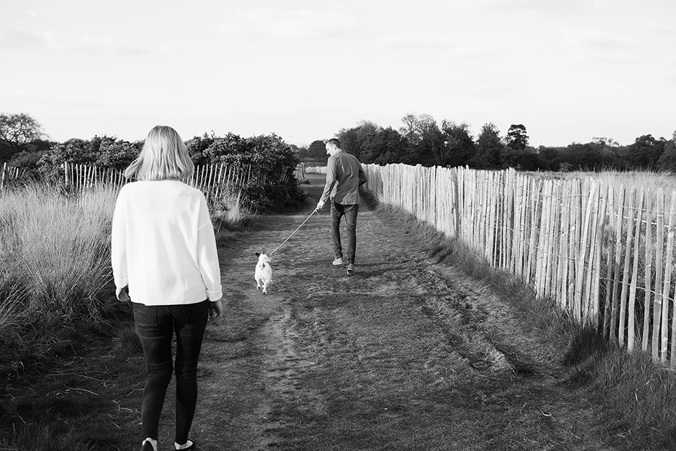 black and white photo in a field with pet dog