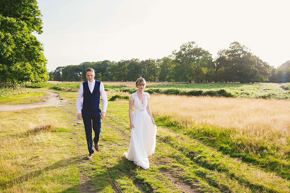 cretive wedding photography in a field sunshine portraits with the bride and groom sunshine coast wedding photographer