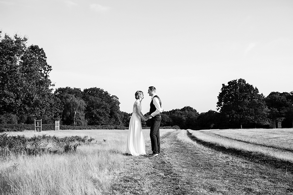 black and white wedding photographer brisbane in a field