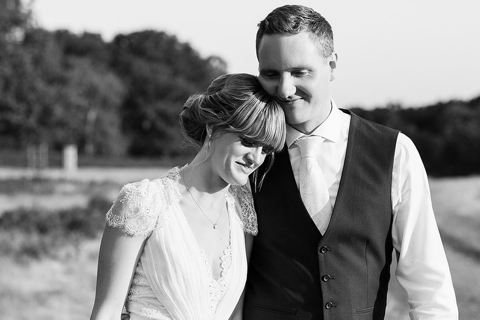 black and white wedding photography portrait in a field