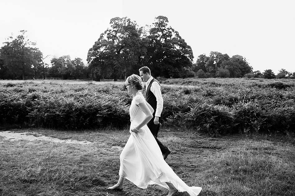 black and white wedding photographer portrait in a field of a brides dress claire pettibone