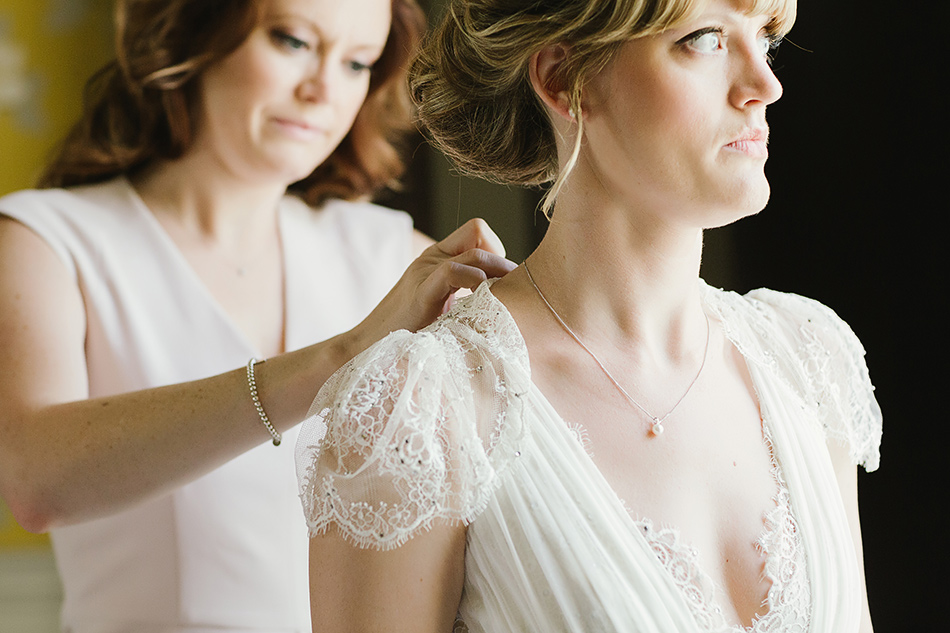 bride getting ready for the wedding day photography claire pettibone wedding dress