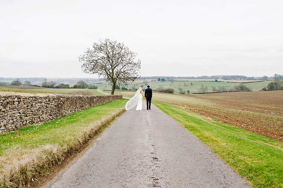 wedding photography in a field for a barn wedding