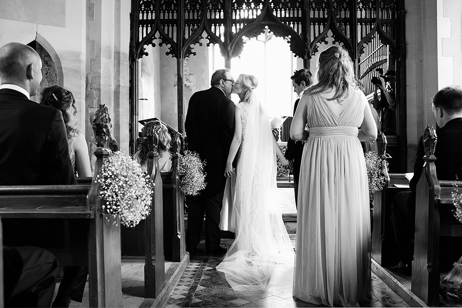 wedding ceremony photography with bridesmaids in st marys church