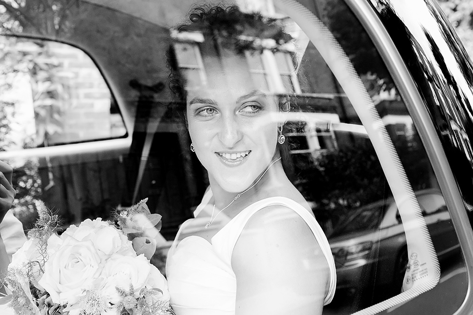 creative wedding photographer brisbane bride and groom leaving the church at chruch wedding