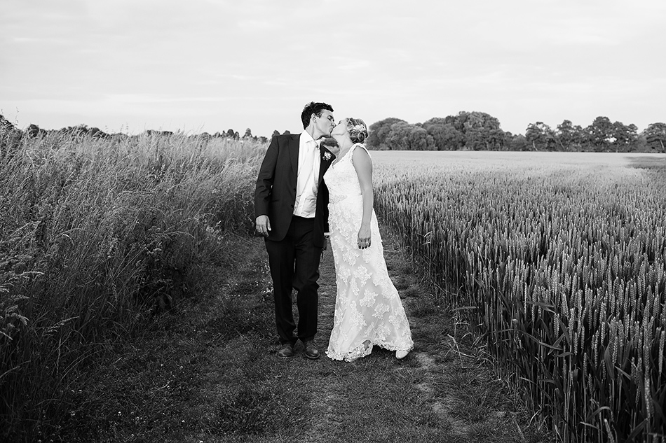 brisbane wedding photographer in a field wedding portraits with bride and groom