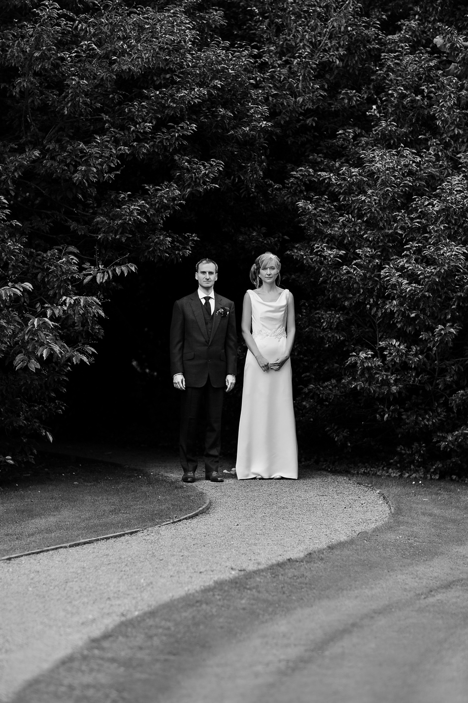 black and white wedding photographer in the garden a portrait of a bride and groom rustic wedding