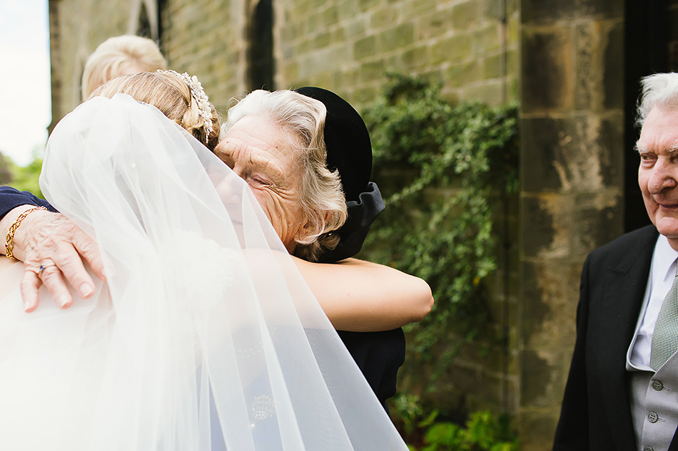 hugs with family photography on the wedding day