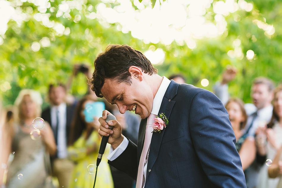 groom singing at wedding reception in brisbane