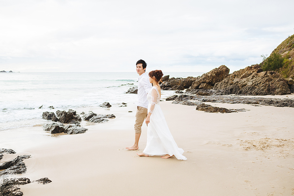 beach wedding portraits for couples for pre wedding portrait session by creative brisbane wedding photographer at the beach