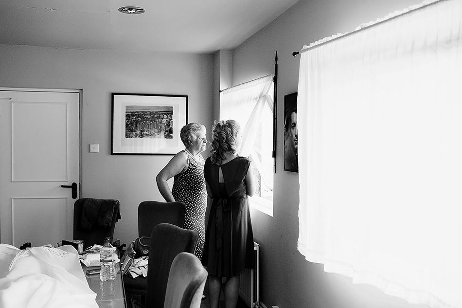 black and white wedding photographer bride getting ready with mum