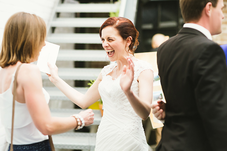 bride greeting guests at wedding reception brisbane wedding photographer