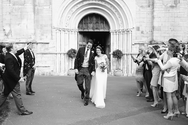 wedding photography outside church black and white photography confetti photo