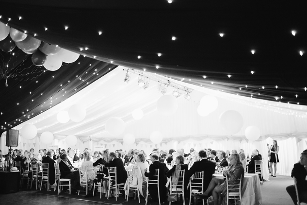 black and white wedding photography in a tent with balloons