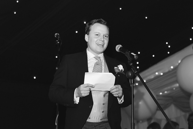 black and white photography cool wedding photographer during speeches