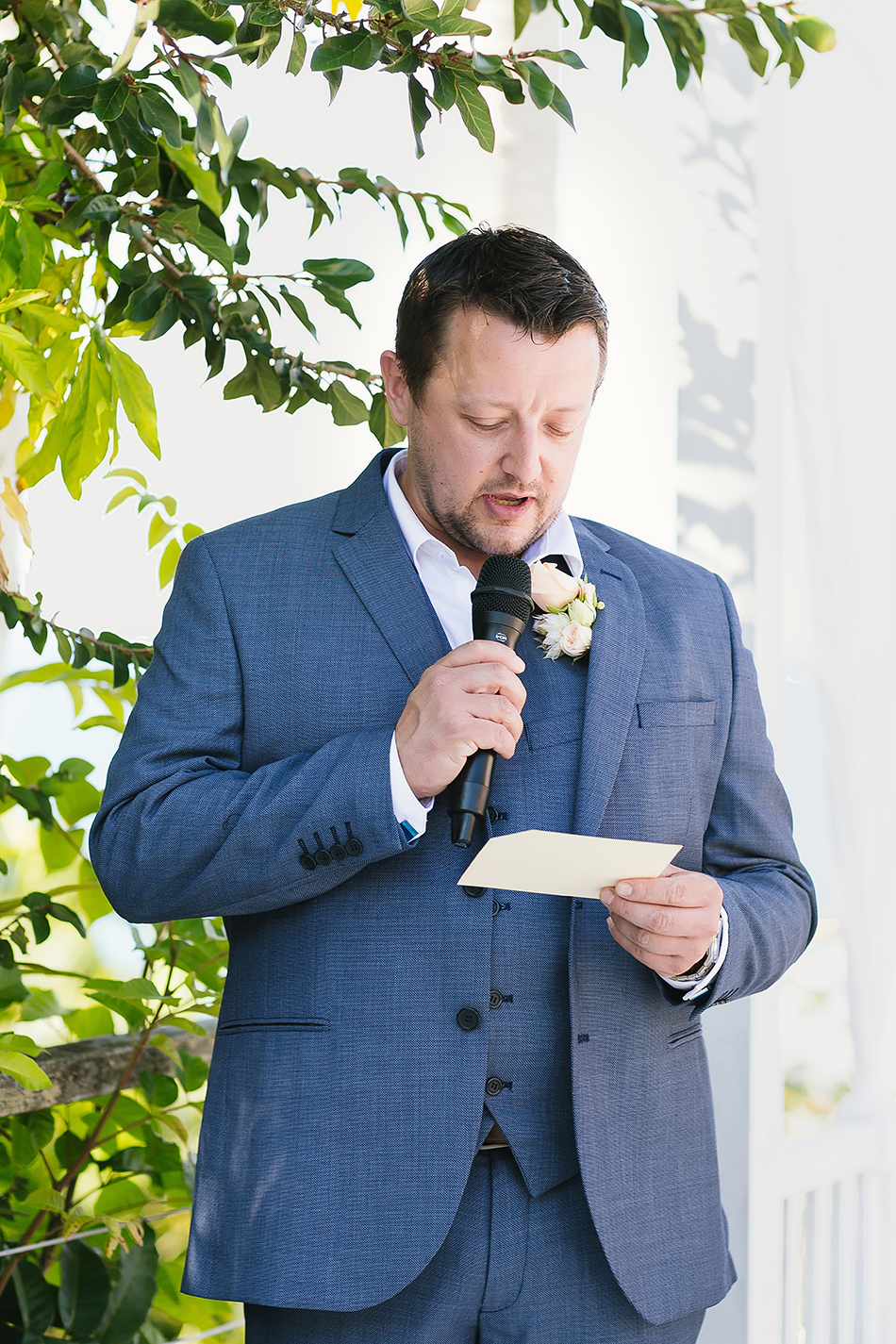 groom saying his words at the wedding ceremony mission beach