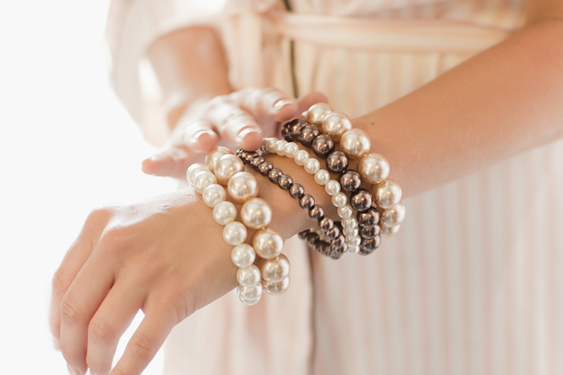 bridesmaid accessories reportage photography pastel pink bangles and beads
