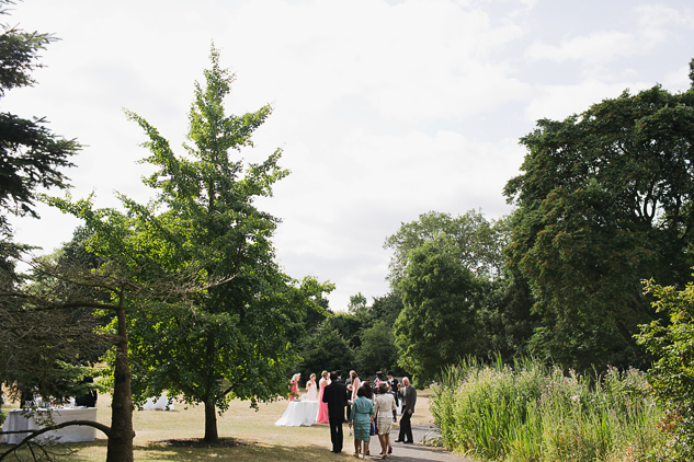 creative wedding photography wedding drinks in the sun and reception by clair estelle kew gardens
