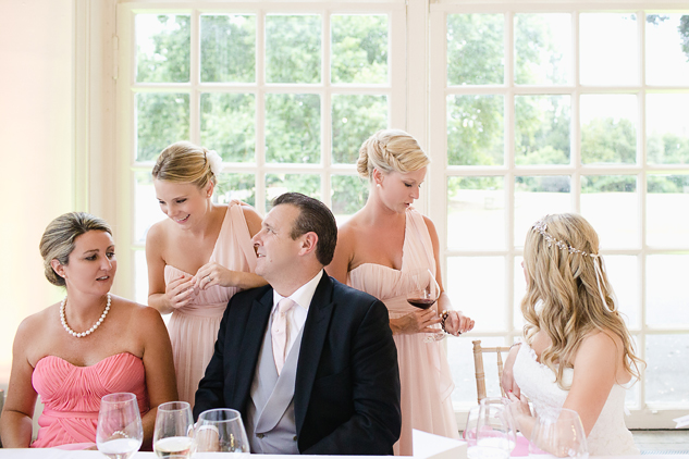 wedding guests eating meal in a creative wedding photograph