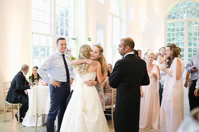 guests chatting at wedding reception at the orangery at kew gardens