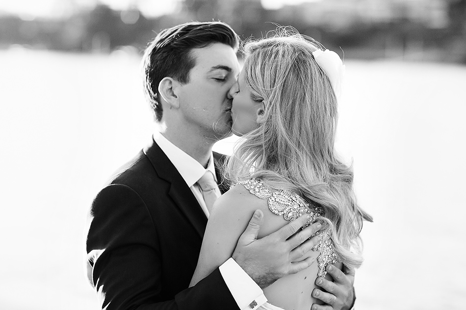 black and white wedding photographer brisbane wedding toowong rowing club wedding portraits with bride and groom on the river