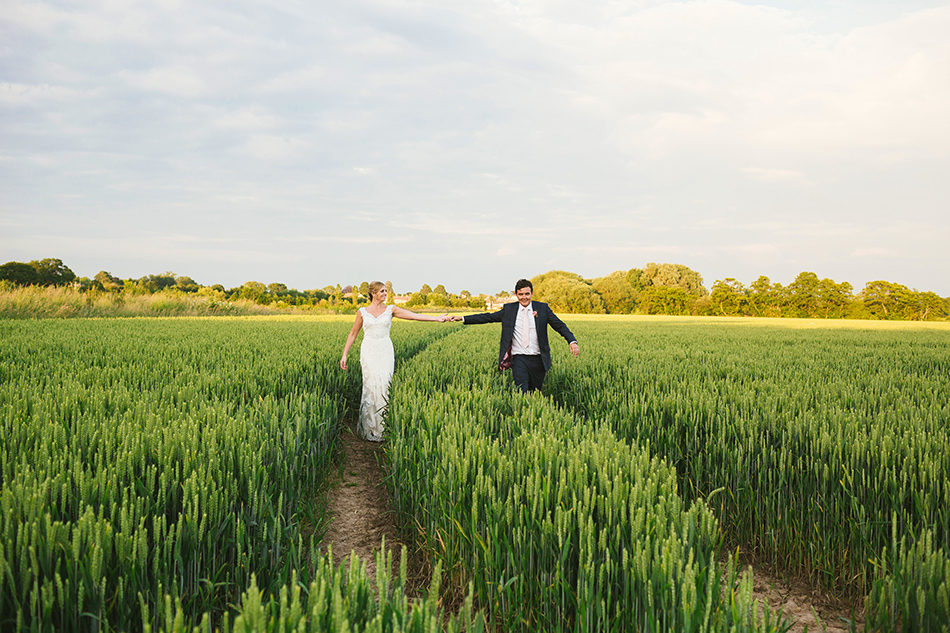 wedding photographer portraits in a  field