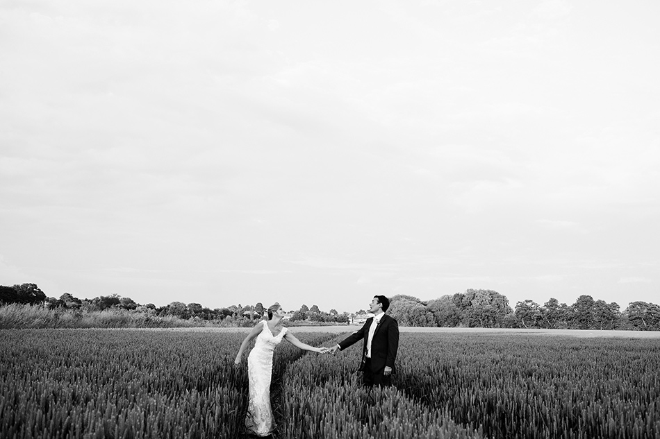 creative wedding photographer brisbane creative wedding portraits in a field barn wedding