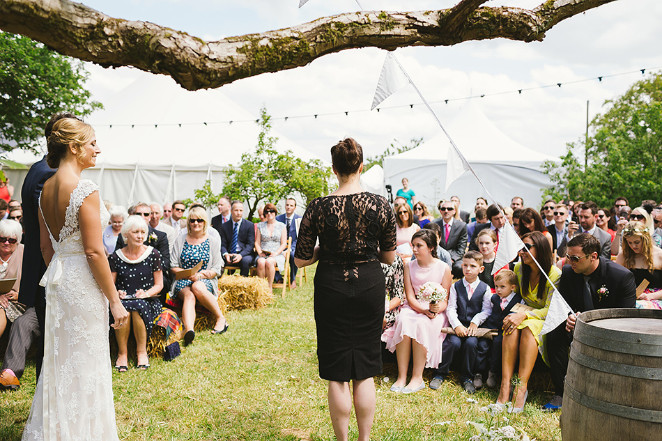 crative wedding photographer at a garden wedding ceremony