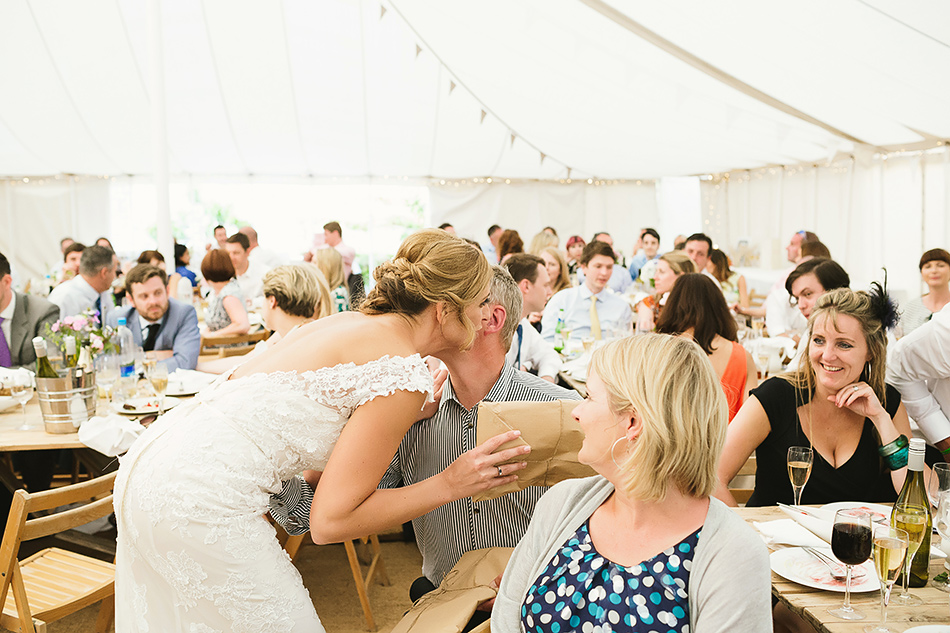 creative wedding photography in a tent evening wedding celebrations and speeches