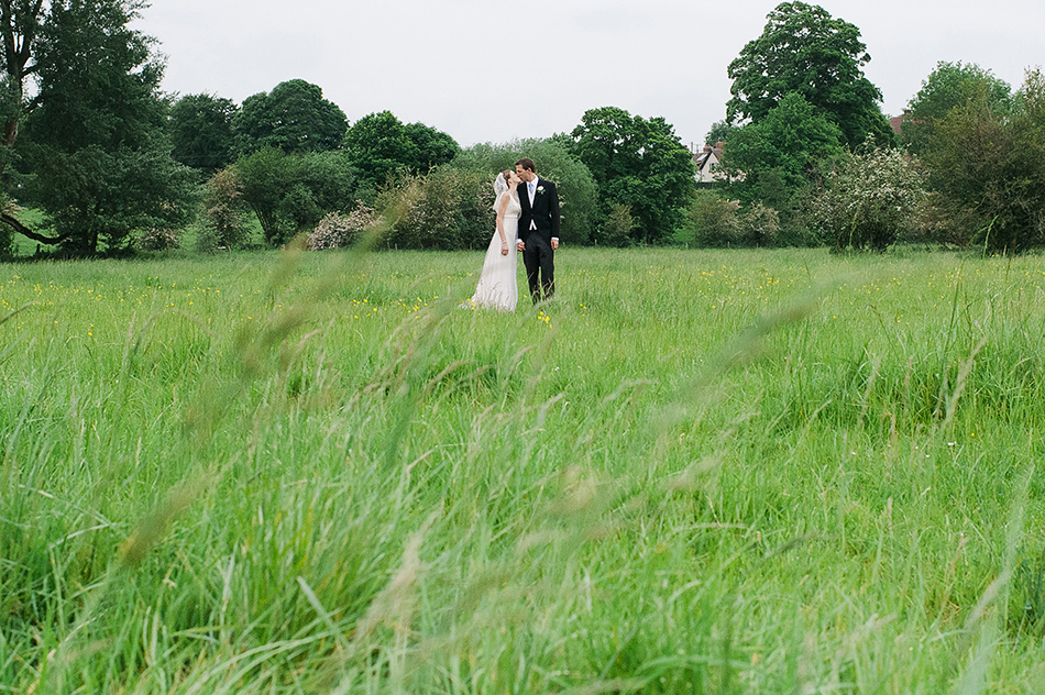 creative reportage wedding photography in a farm field diy boho outdoors tipi whiltshire 0002