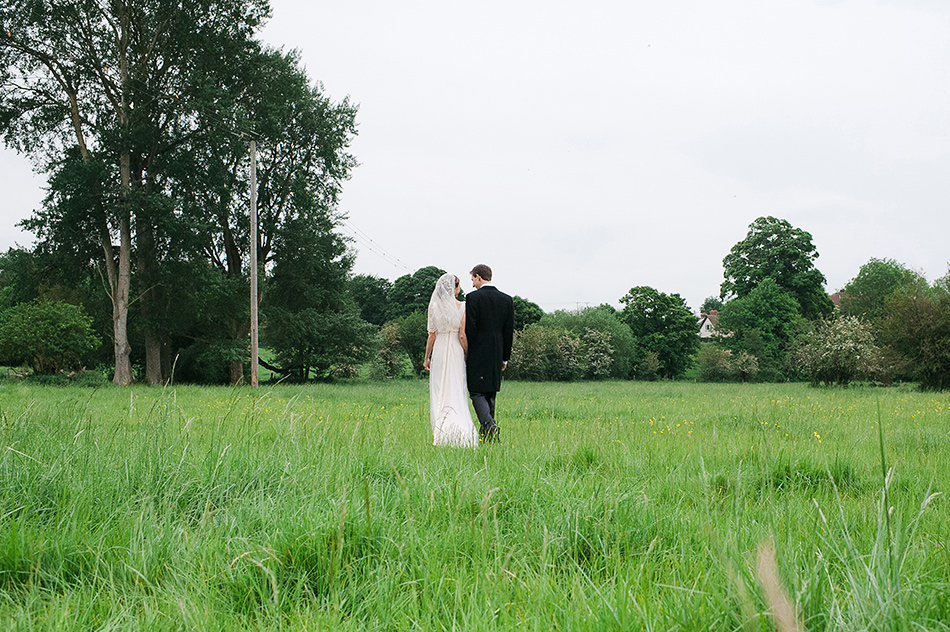 creative reportage wedding photography in a farm field diy boho outdoors tipi whiltshire 0009
